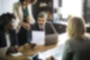 older man in meeting.jpg