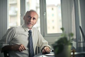 businessman at desk.jpeg