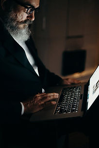older businessman with laptop.jpeg