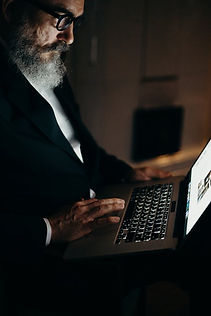 older businessman with laptop.jpeg