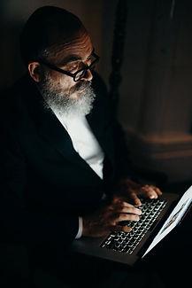 Older man with laptop.jpeg
