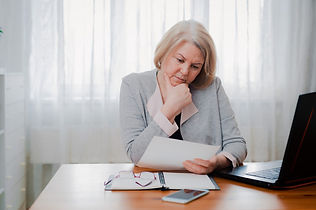 older woman reviewing report.jpg