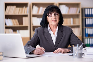 older woman working at desk.jpg