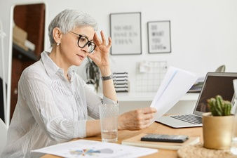 woman with glasses at desk.jpg