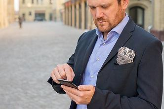 man on street w-phone.jpg
