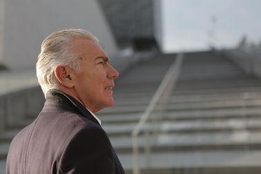 older businessman outdoors.jpg