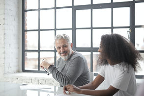older man working with woman.jpg