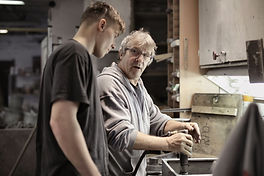 older worker with younger 07JUL.jpg