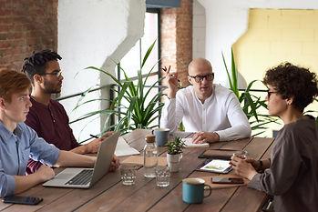 man leading meeting.jpg