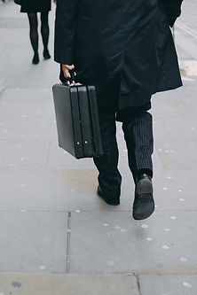 man on street with suitcase.jpg