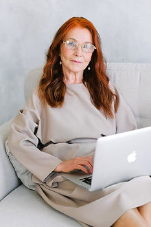 red-haired woman with laptop.jpeg