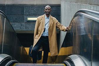 businessman on escalator.jpeg