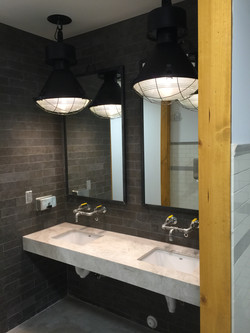 steel mirrors above sink