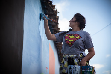 Girl painting a mural in tribute to the activist Berta Cáceres killed by soldiers in Intibucá - Honduras