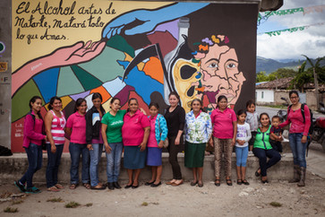 Women in front of a mural denouncing violence against women close to Intibucá - Honduras