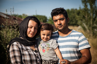 Refugee Family waiting to cross the border between Serbia and Hungary.