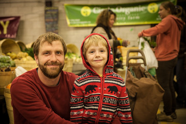 Market gardener and his son at a farmer's market in Peterborough - Canada