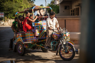 Kids on a Chakkada. It's a Royal Enfield converted into a rickshaw - India