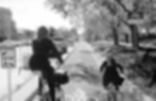 """Woman and girl ride bicycles on the """"Bike About"""" in South Salt Lake"""
