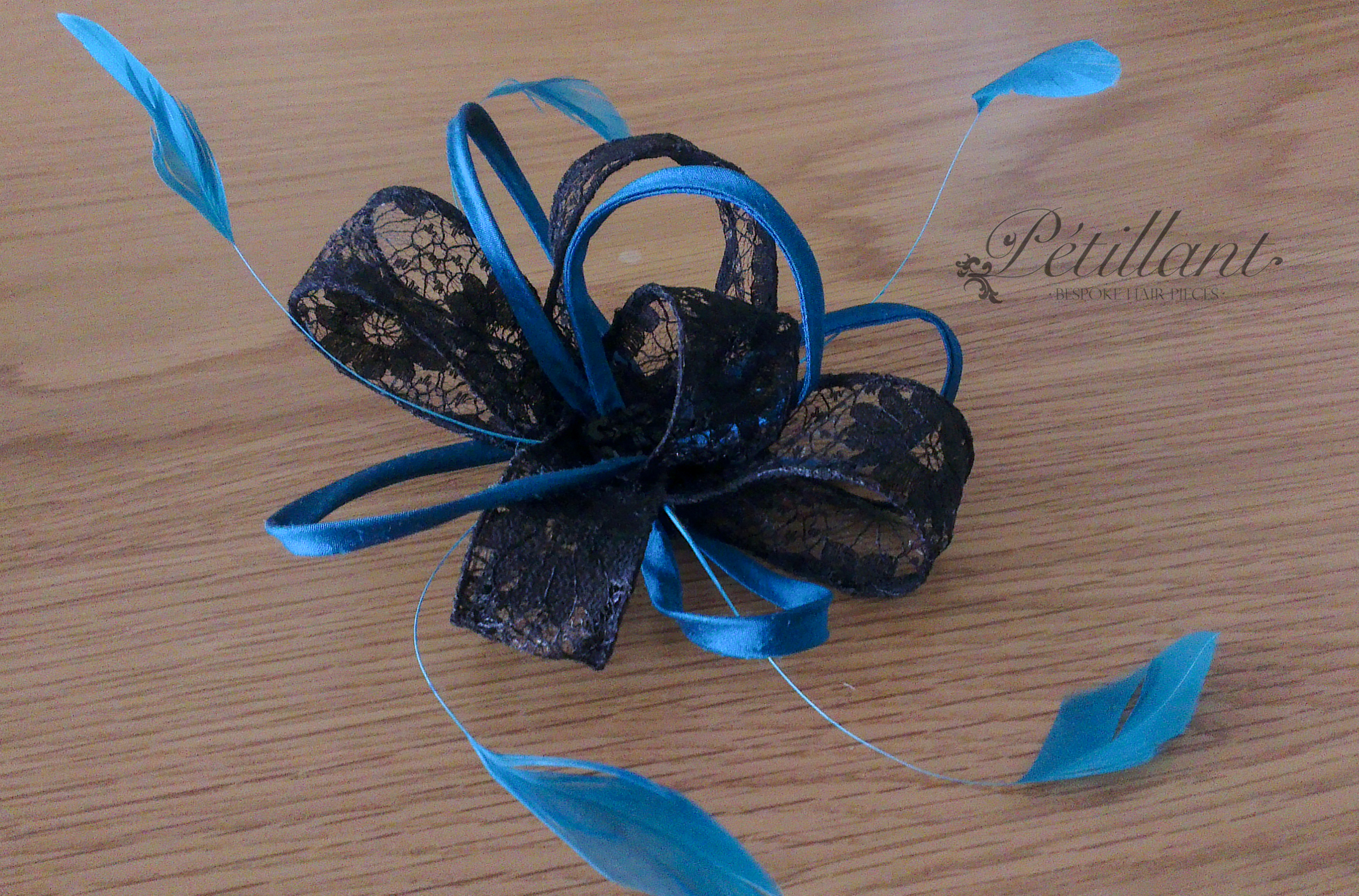 Black and turquoise lace fascinator