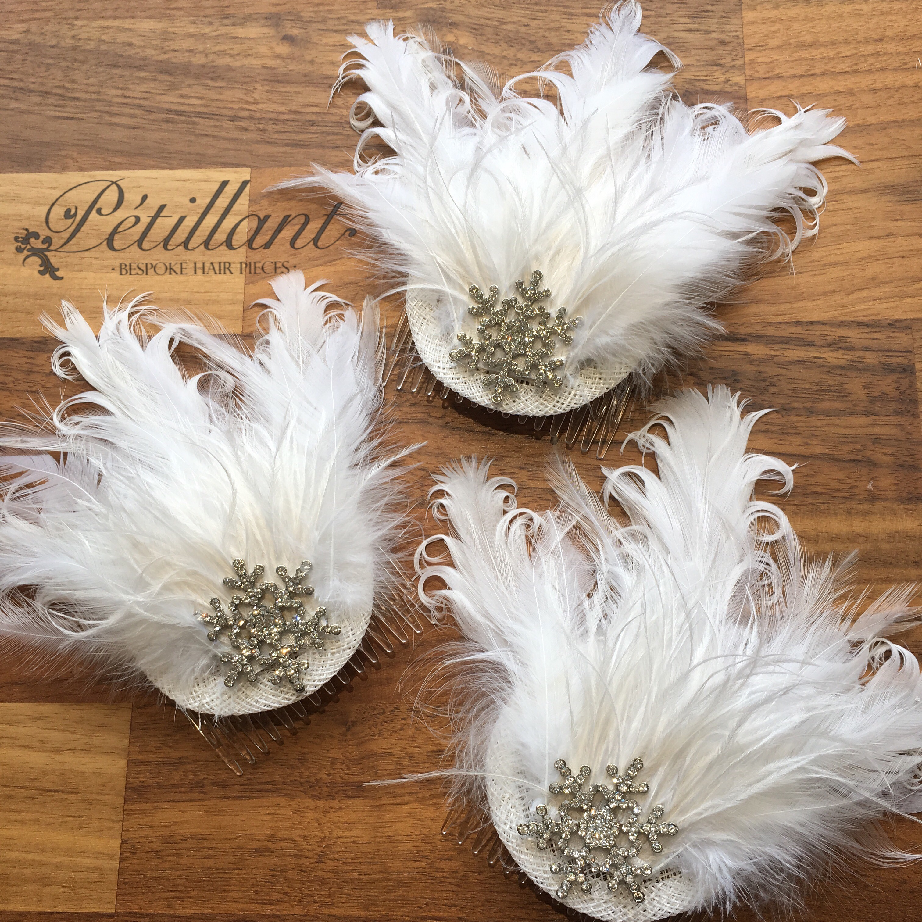 White feather & sparkle fascinators