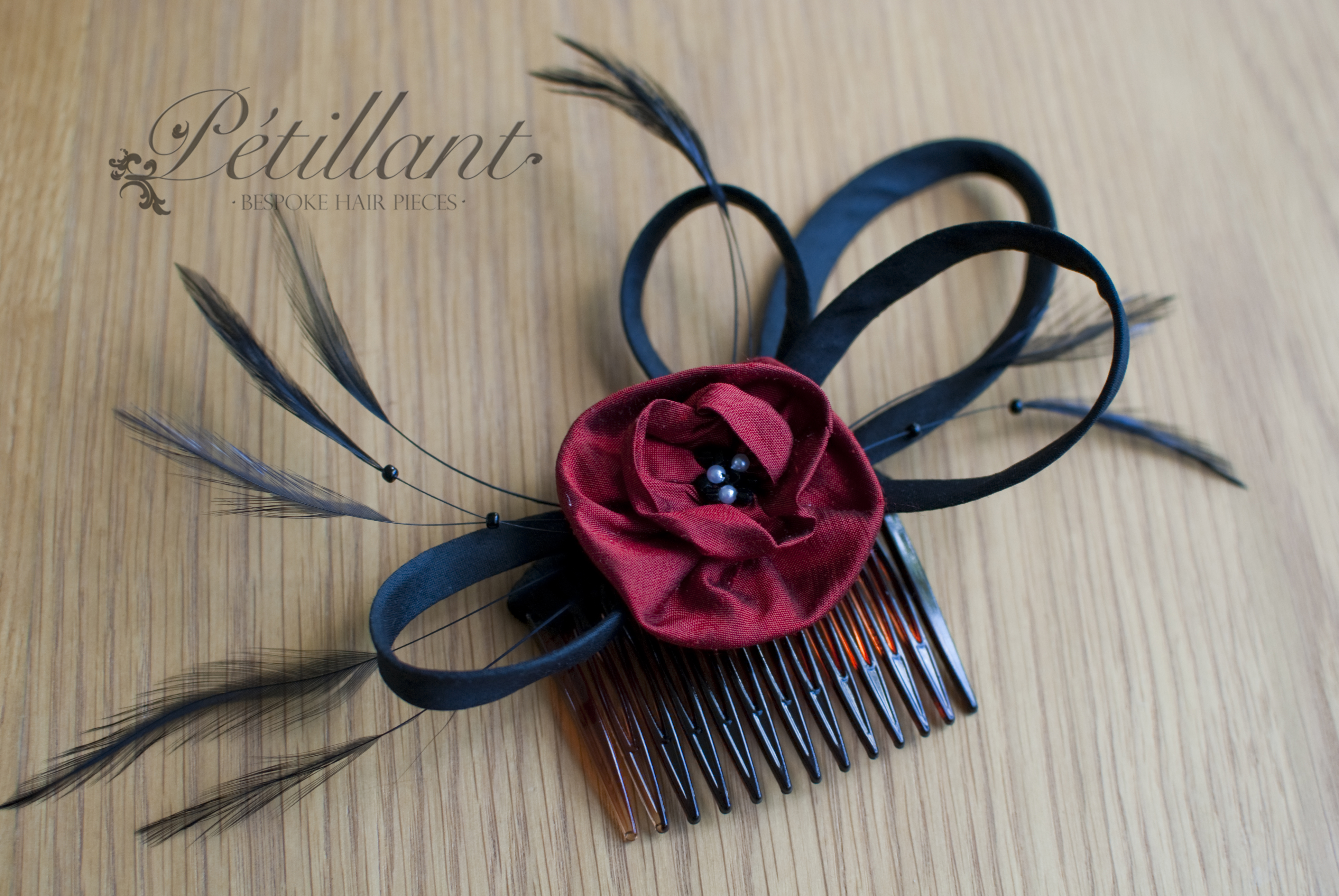 Black and red flower comb