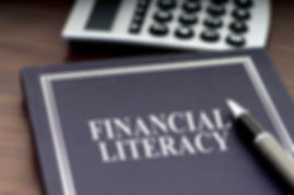 Financial Literacy book with pen and cal