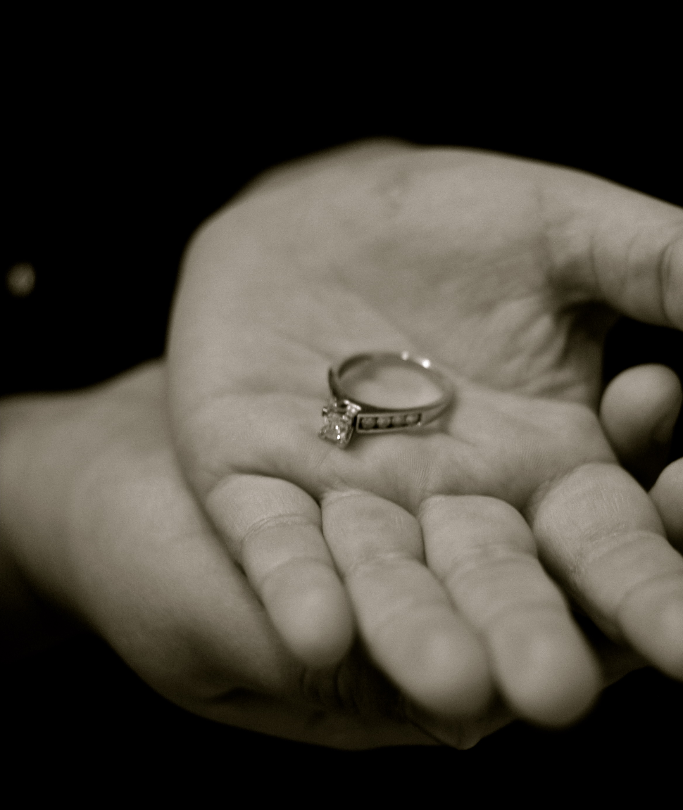 Daughter's hands holding mom's ring
