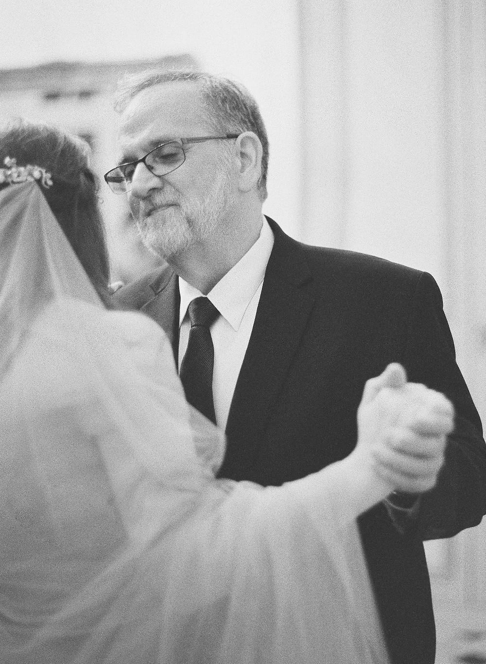 "Me dancing with my dad. We danced to Patty Griffin's ""Heavenly Day."" My dad had me listen to this song a few months before and as soon as I listened to the words I knew that I would surprise him with this song for our dance. It's a great song! / Photo Laura Gordon"