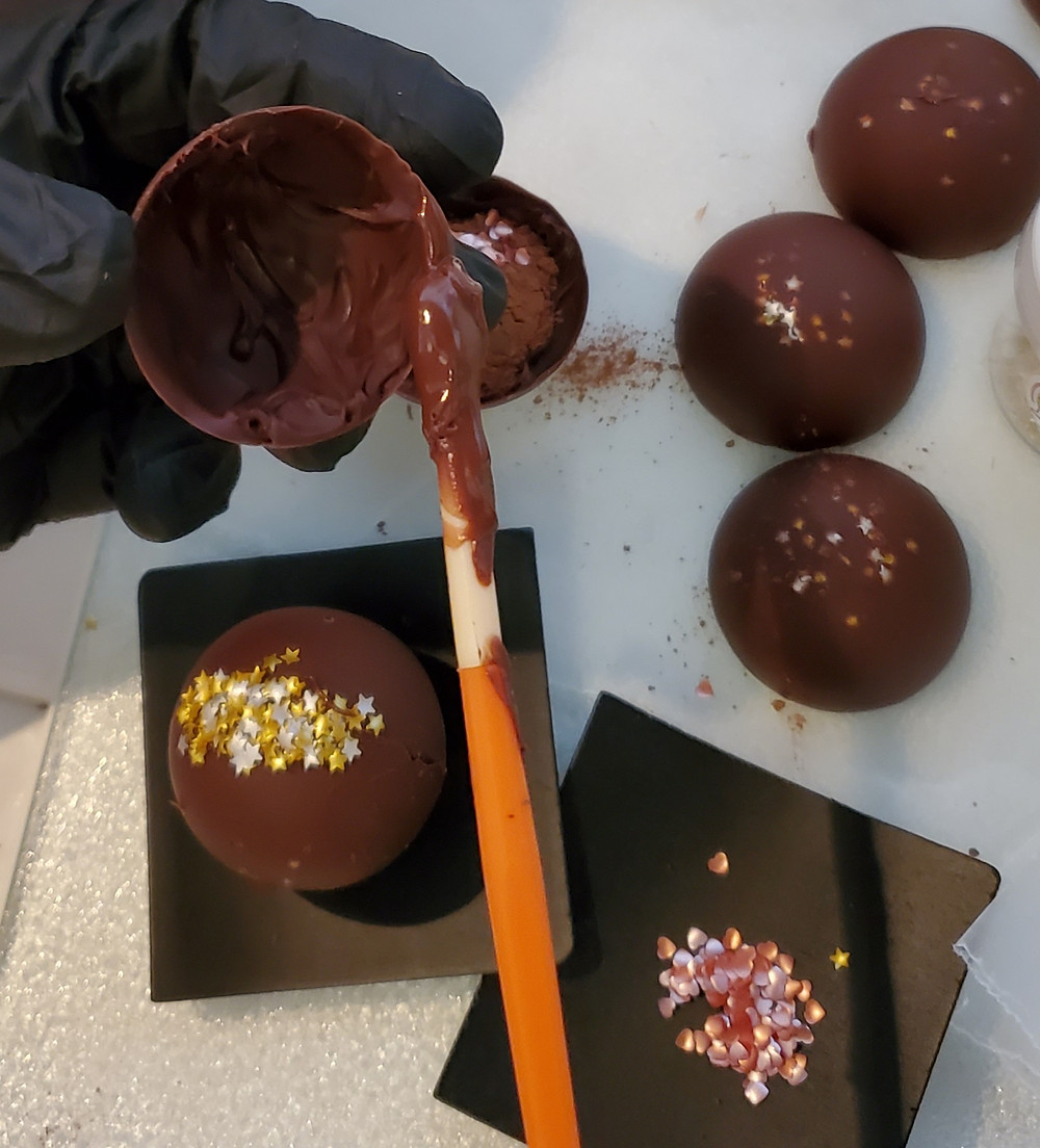 Brushing chocolate on half spheres