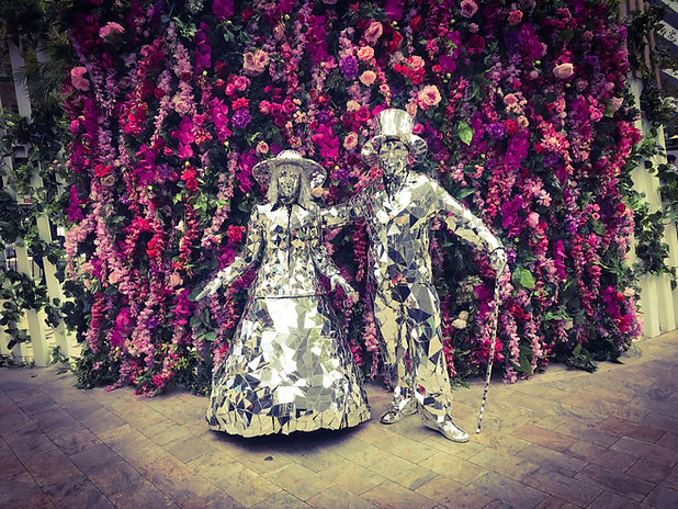 Mirror people posin g in front of a flower wall for an event in North Sydney, Australia
