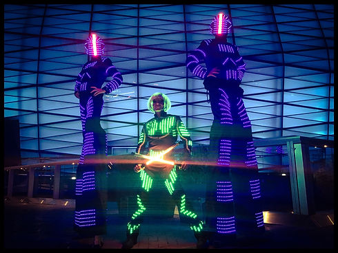LED Performers | tall led robots on stilts availabloe for booking in Sydney