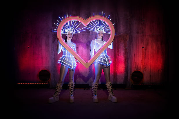 Led performer duo holding a LED love  heart picture frame, great idea for wedding receptions.