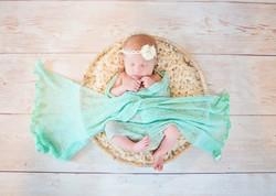 Newborn girl photo in a bowl