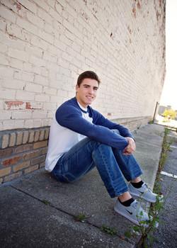 Senior boy brick wall