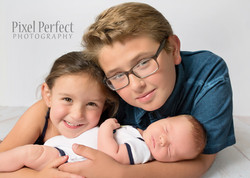 Newborn baby boy with older siblings
