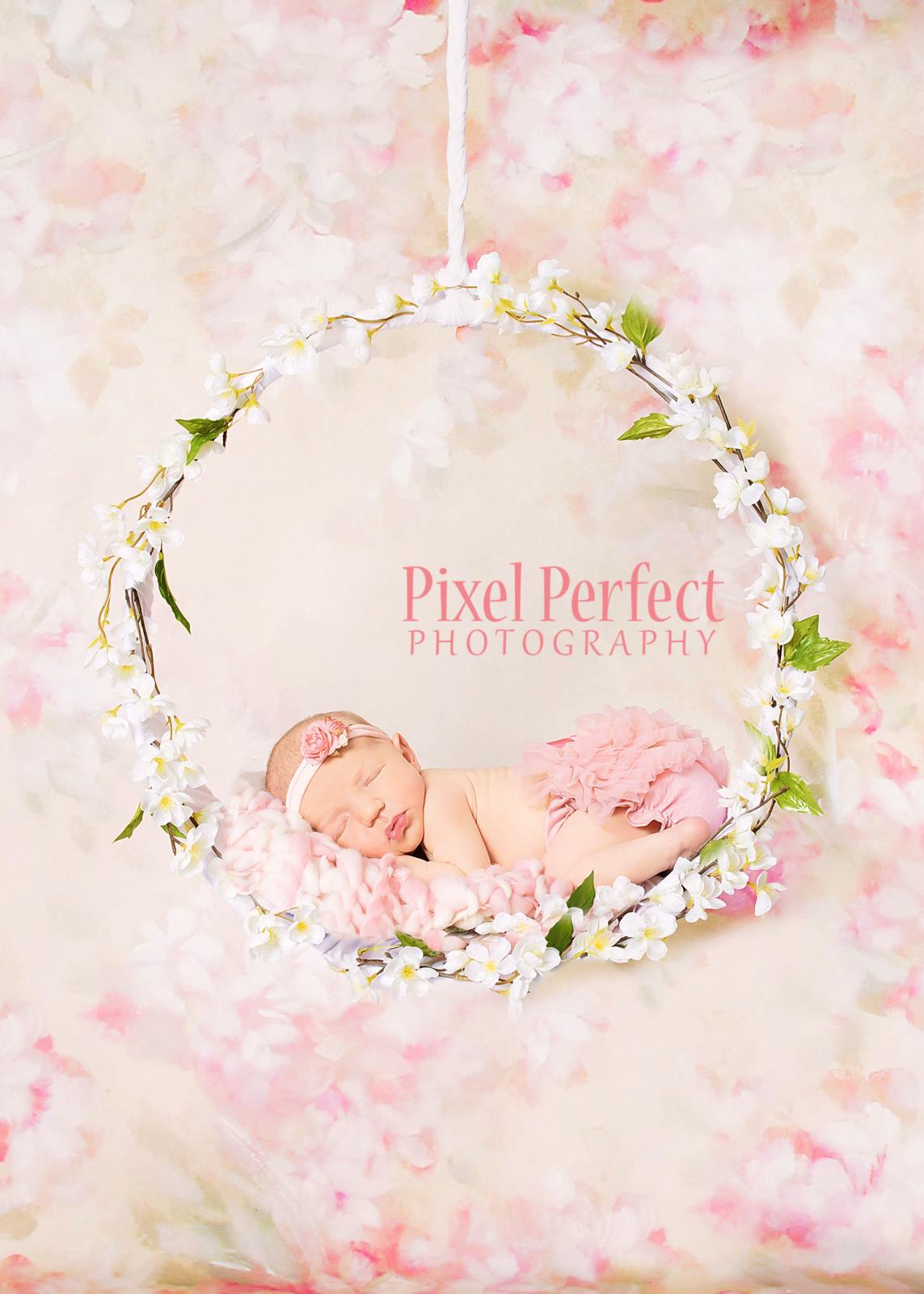 Newborn girl on floral hoop
