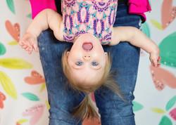 Upside down 1yr old girl