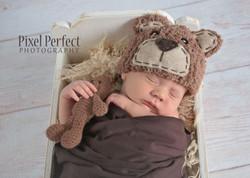 Newborn baby boy with teddy bear