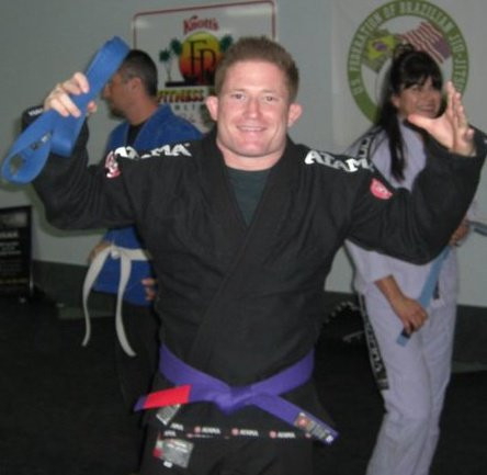 fama singapapore Professor Robyn being promoted to Purple Belt in 2010