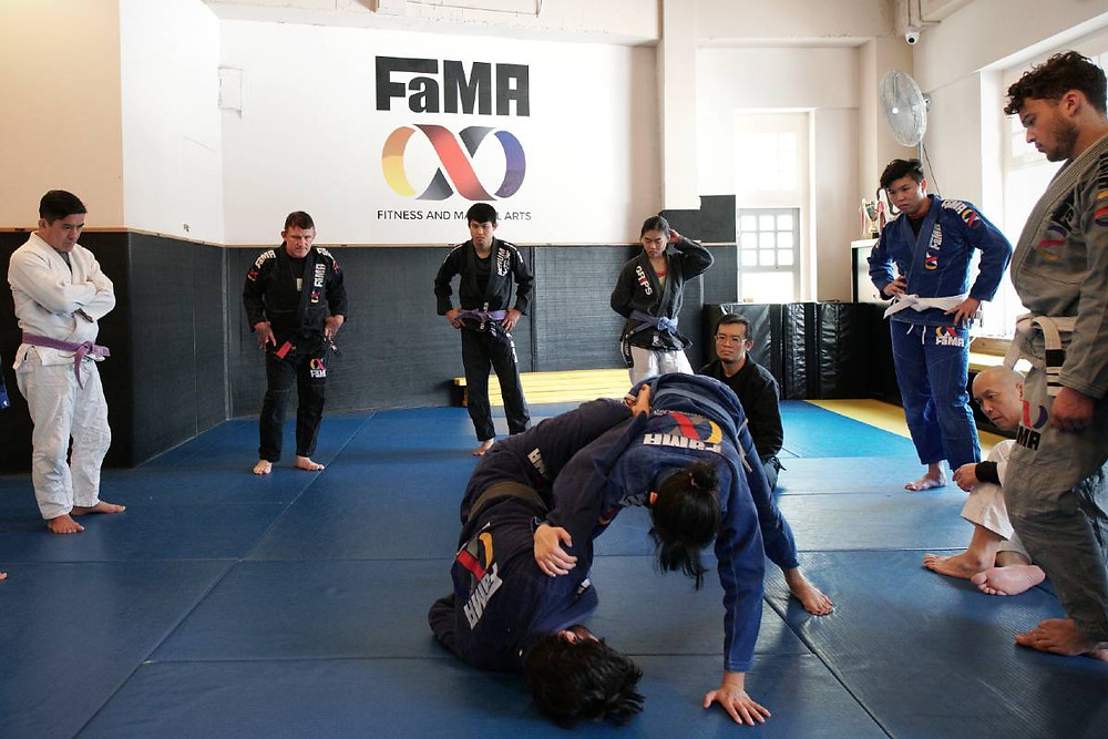 fama singapore bjj class butterfly sweep