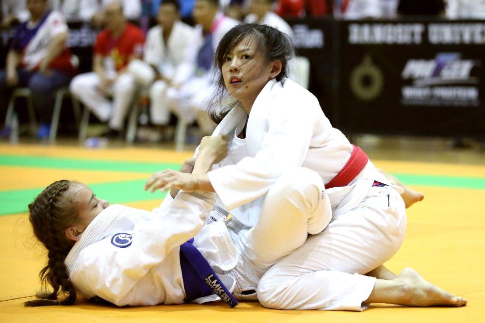 fama singapore assistant instructor sue ann competition singapore team