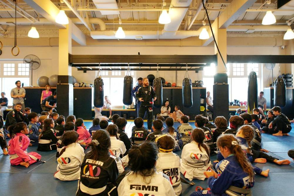 fama singapore professor robyn addressing the kids brazilian jiu jitsu bjj students