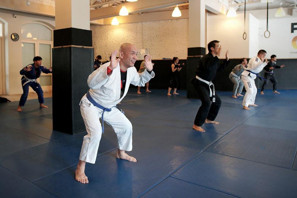 fama singapore martial arts bjj brazilian jitsu bjj muay thai kickboxing group warm up