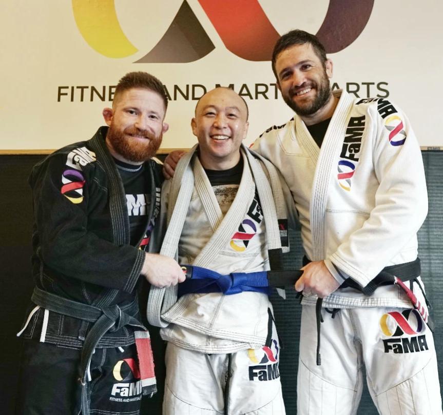 fama singapore assistant instructor tim promoted to blue belt