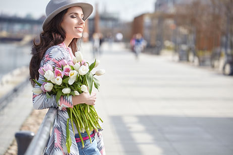 girl holding flowers.jpeg