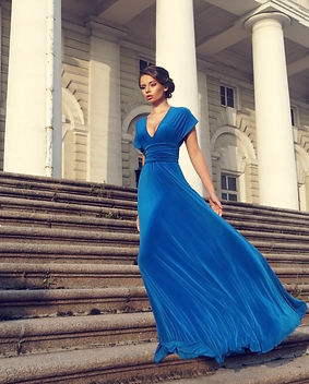 Bonita Bold_blue gown walking on steps
