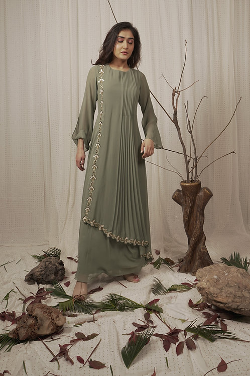 DRAPPED CAPE DRESS WITH EMBROIDERY ON BORDER