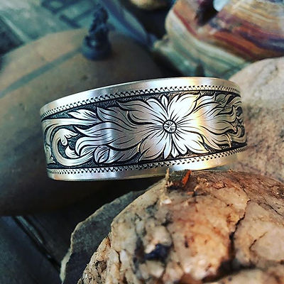 Flowing flower cuff, measures 6_ long and .75_ wide. Hand-engraved sterling silver, $200.jpg