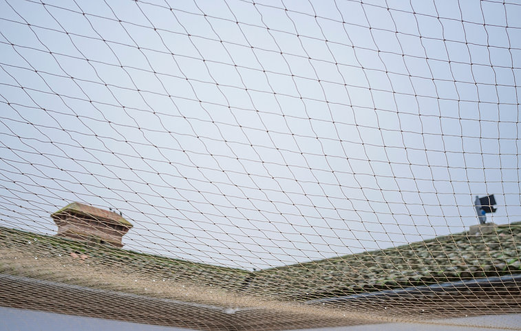 Net covering courtyard area to protect b